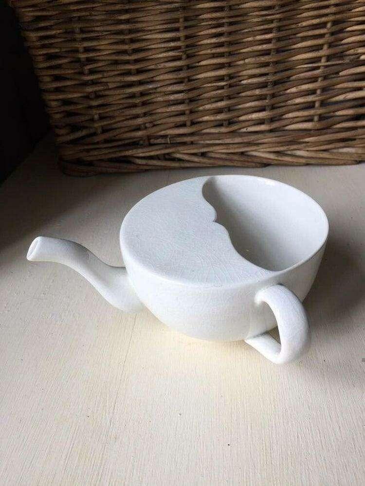 Может ли кто подсказать, что это за необычный чайник?